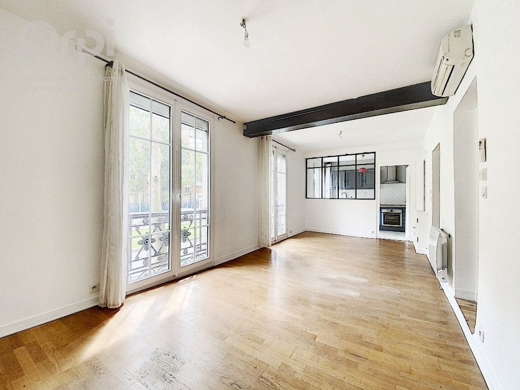 Appartement à vendre 3 51.63m2 à Paris 20 vignette-1