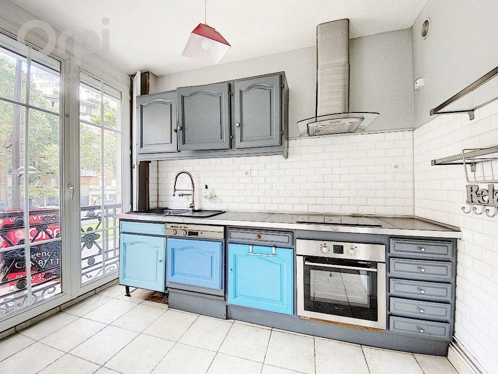 Appartement à vendre 3 51.63m2 à Paris 20 vignette-2