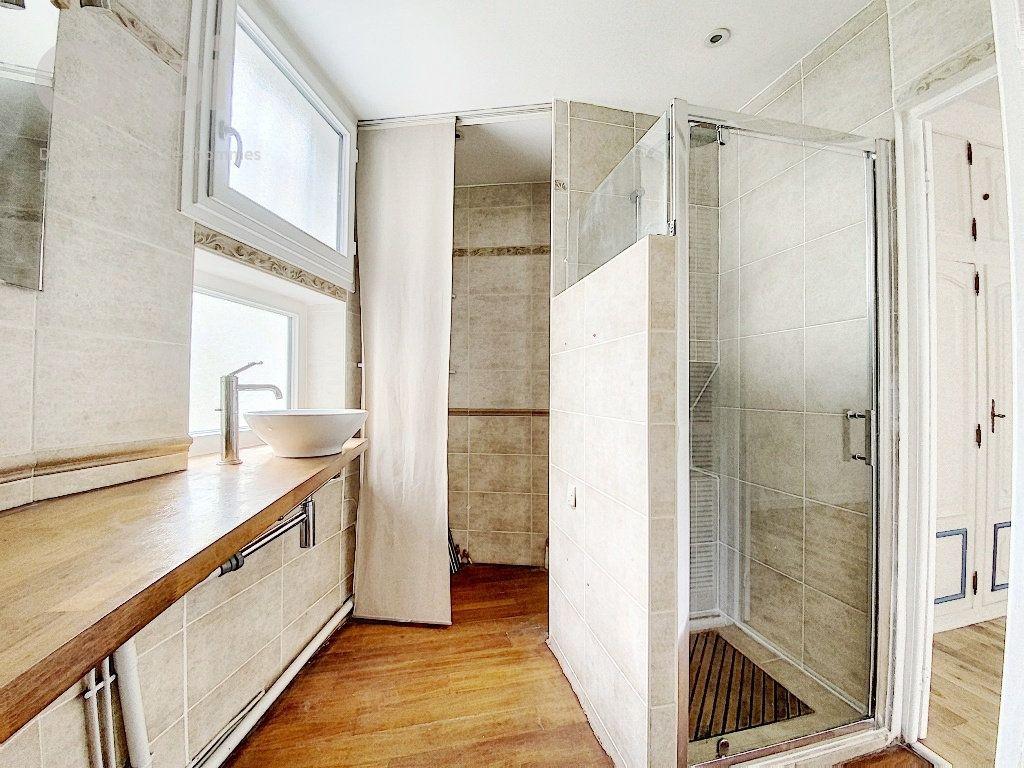 Appartement à vendre 3 51.63m2 à Paris 20 vignette-4