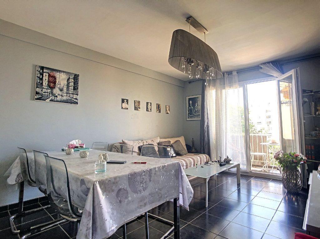 Appartement à vendre 3 61m2 à Juan-les-Pins - Antibes vignette-2
