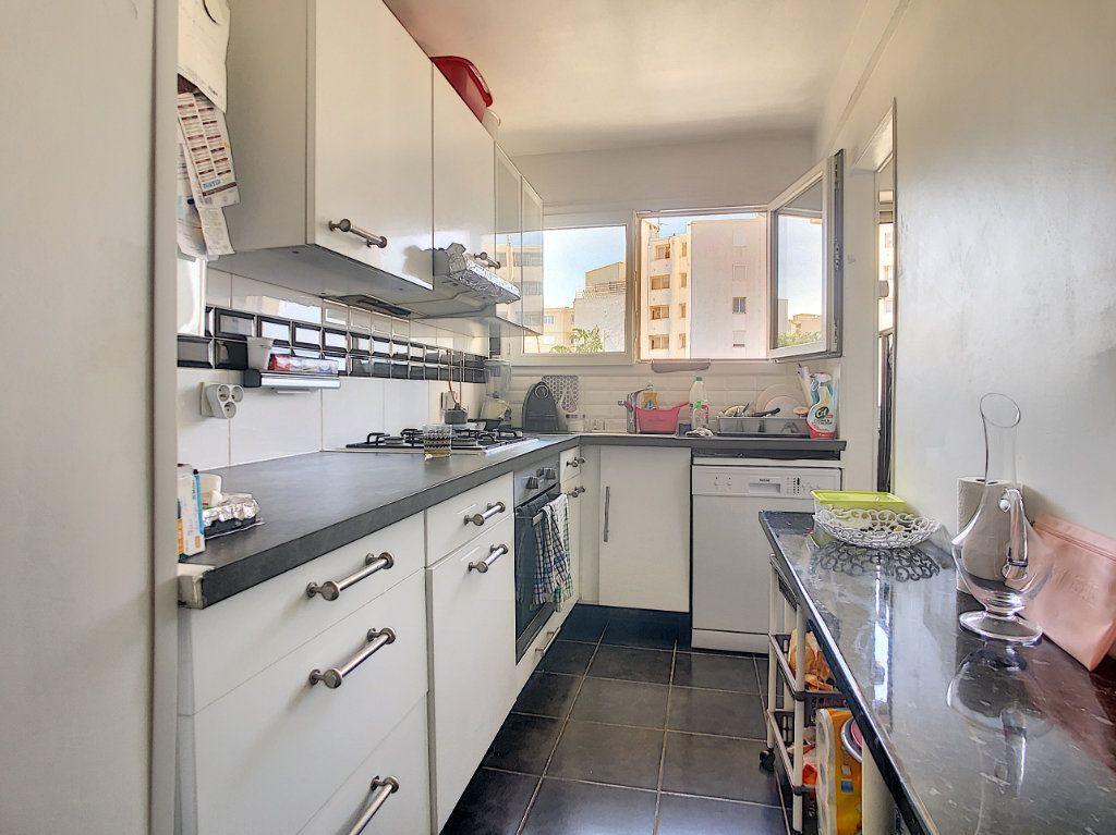 Appartement à vendre 3 61m2 à Juan-les-Pins - Antibes vignette-3