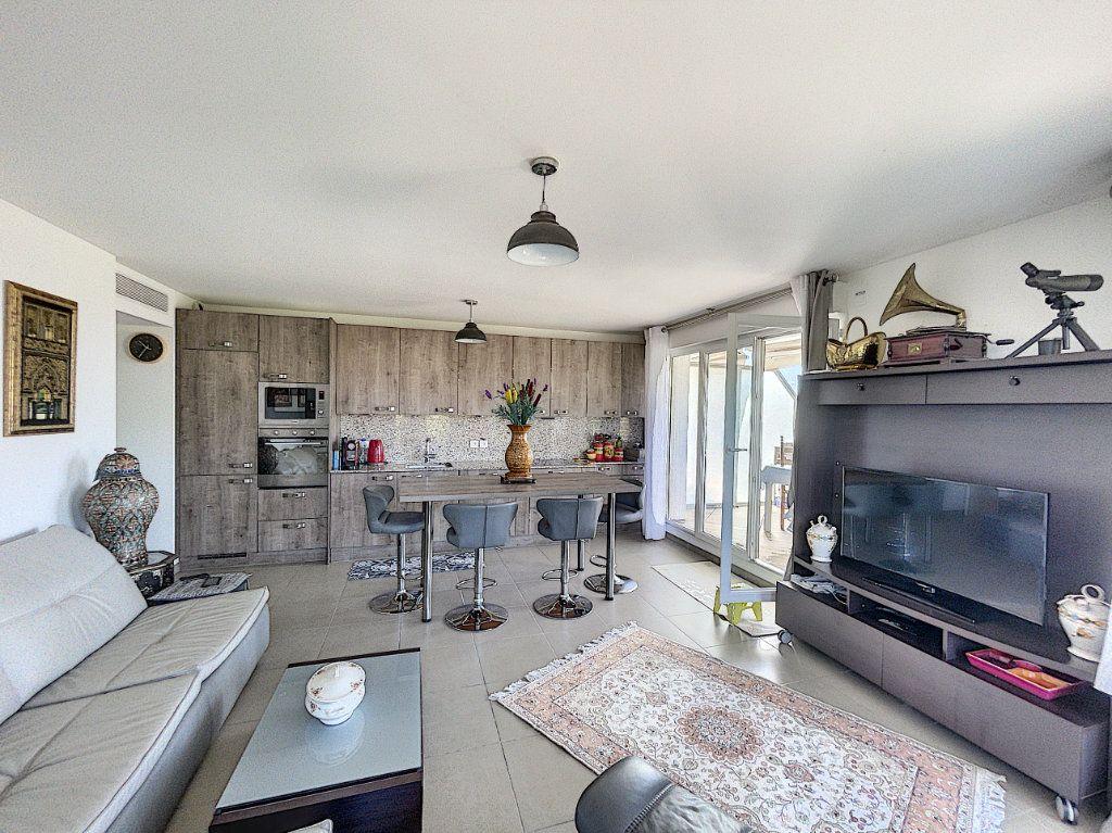 Appartement à vendre 3 63.27m2 à Antibes vignette-4