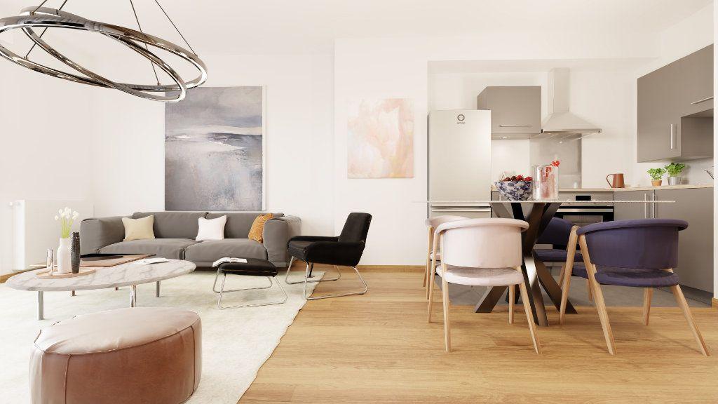 Appartement à vendre 3 61m2 à Notre-Dame-d'Oé vignette-5