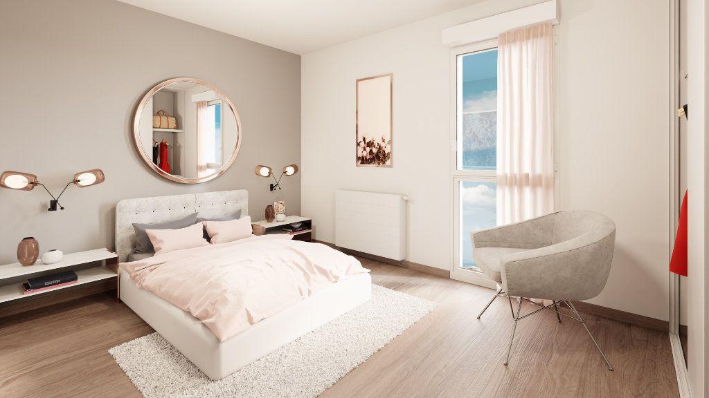 Appartement à vendre 3 61m2 à Notre-Dame-d'Oé vignette-6