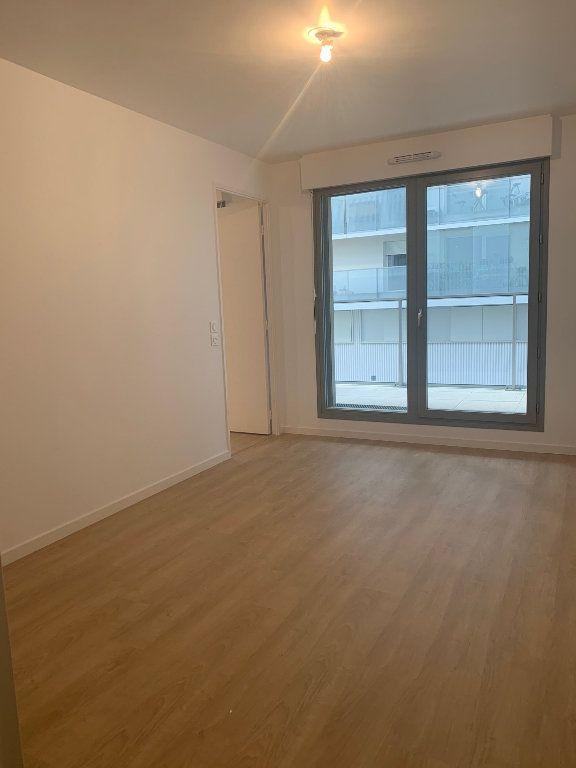Appartement à louer 2 49.5m2 à Asnières-sur-Seine vignette-3