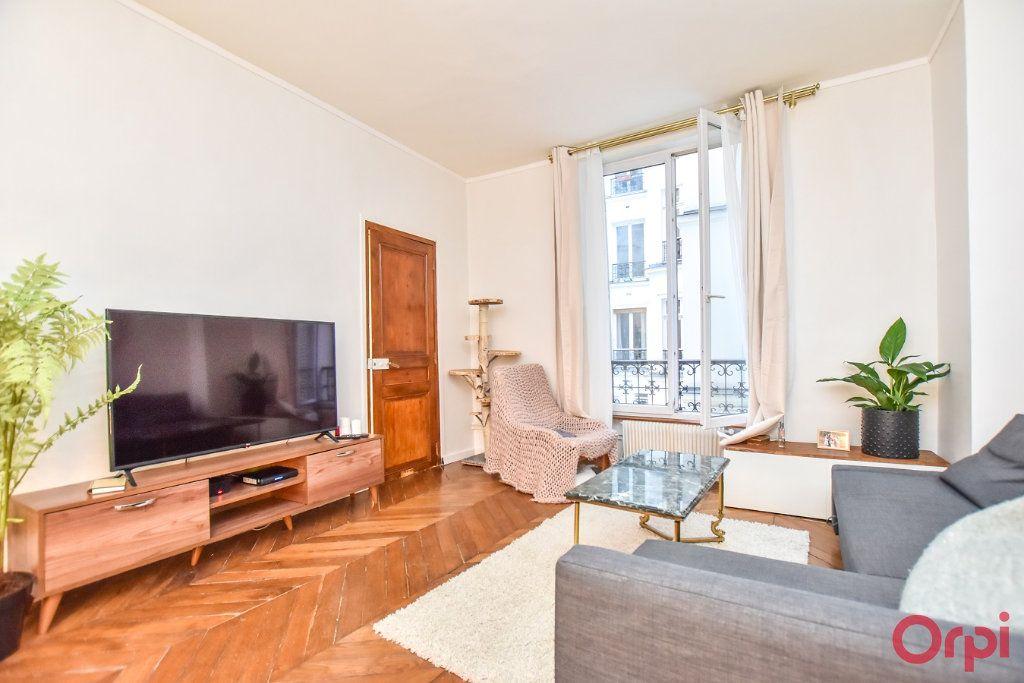 Appartement à vendre 2 49.68m2 à Paris 9 vignette-1
