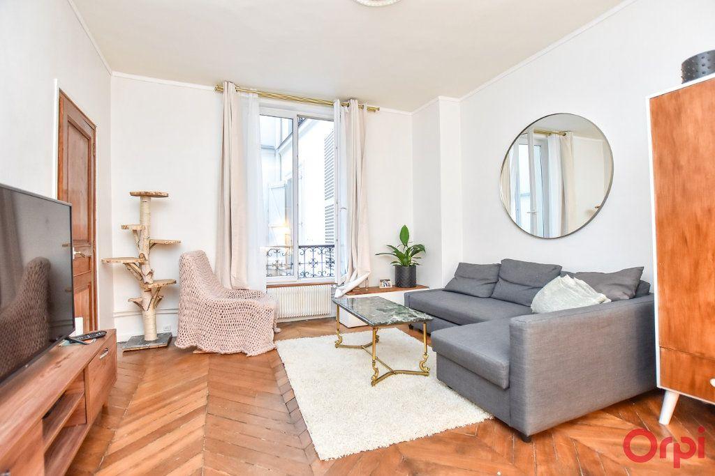 Appartement à vendre 2 49.68m2 à Paris 9 vignette-2