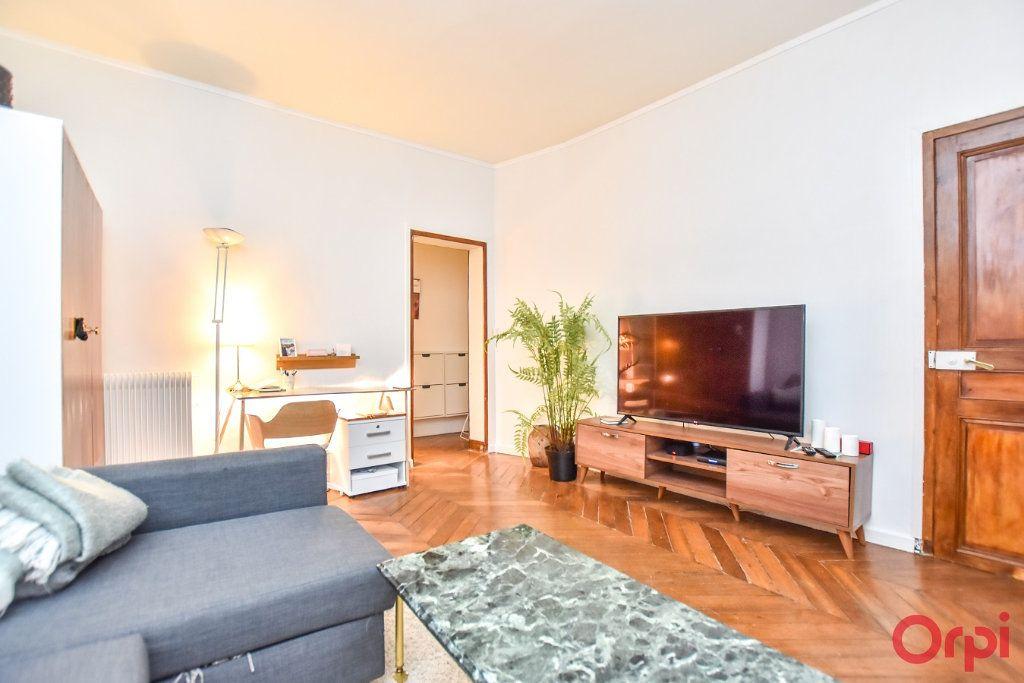 Appartement à vendre 2 49.68m2 à Paris 9 vignette-4
