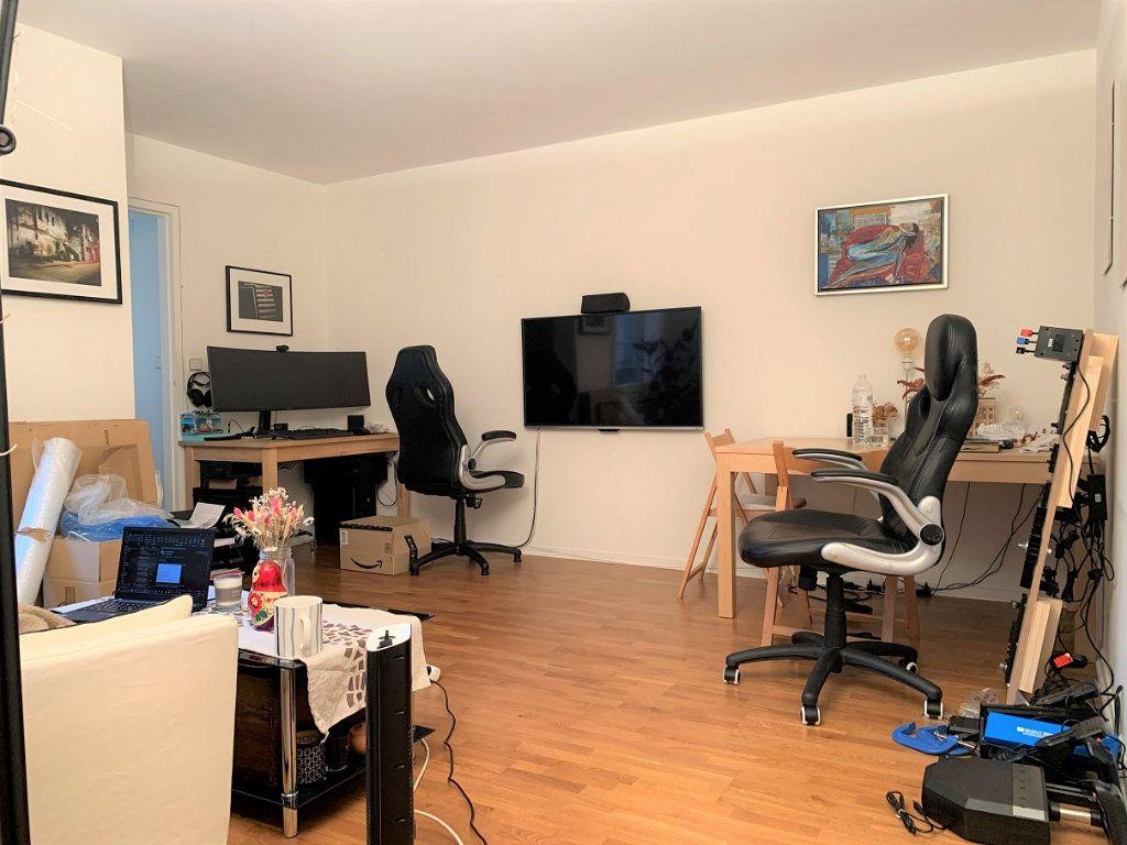Appartement à louer 2 44.1m2 à Paris 2 vignette-2