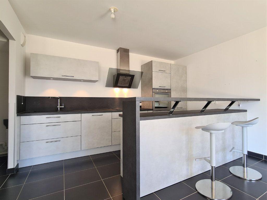 Appartement à vendre 3 66.57m2 à Saint-Genis-Pouilly vignette-1