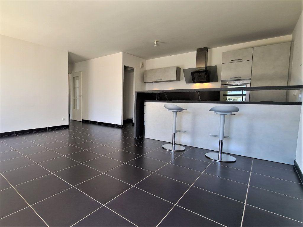 Appartement à vendre 3 66.57m2 à Saint-Genis-Pouilly vignette-2
