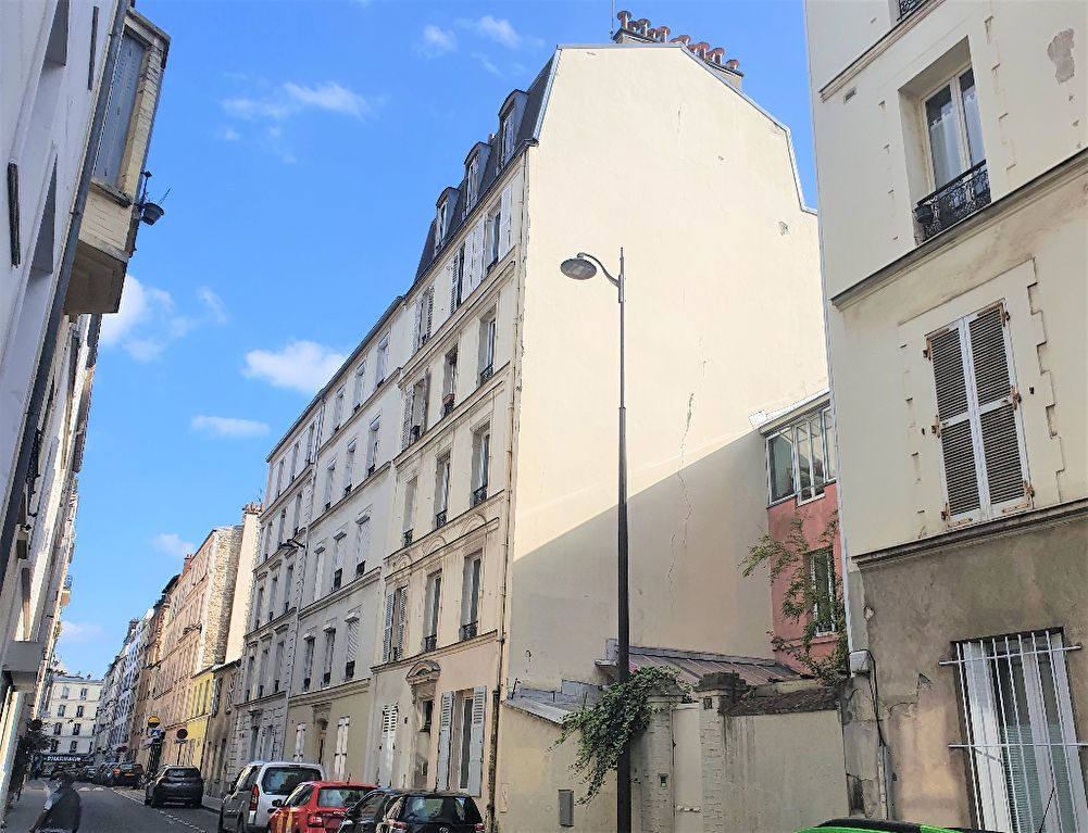 Appartement à vendre 3 48.7m2 à Paris 14 vignette-8