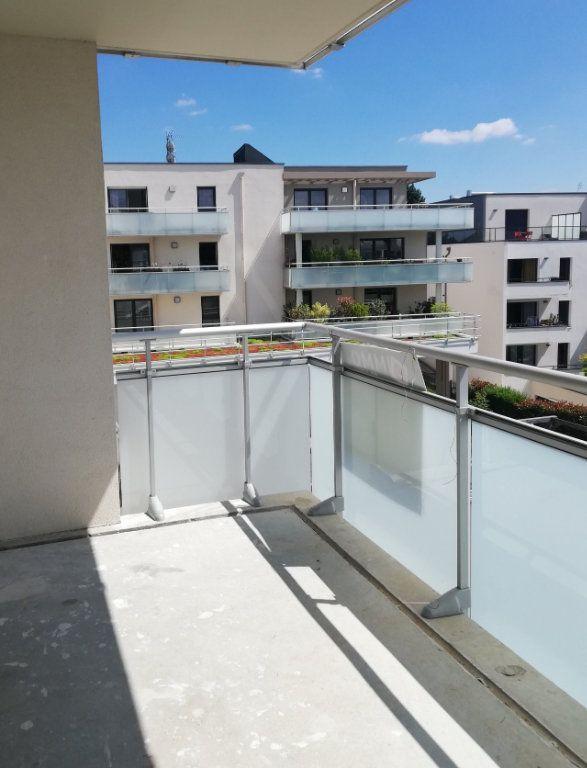 Appartement à louer 3 58.03m2 à Bois-Guillaume vignette-1