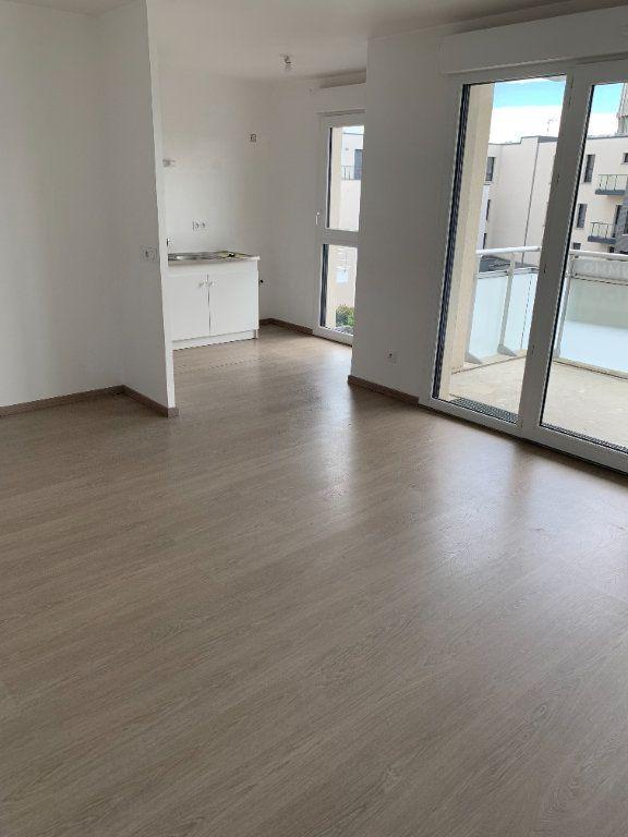 Appartement à louer 3 58.03m2 à Bois-Guillaume vignette-2