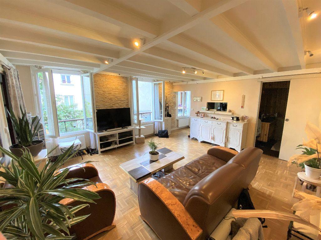 Appartement à vendre 2 49m2 à Paris 19 vignette-2