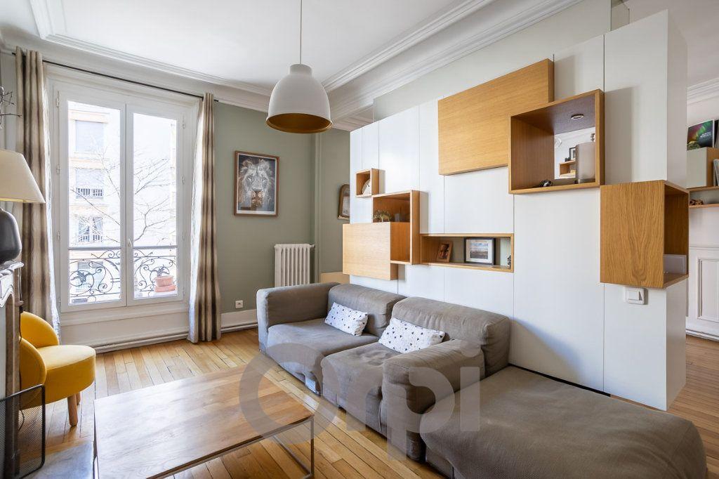 Appartement à vendre 4 73m2 à Paris 19 vignette-2