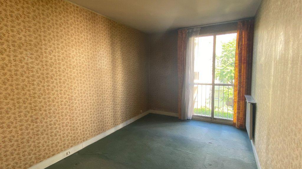 Appartement à vendre 3 69m2 à Paris 19 vignette-5