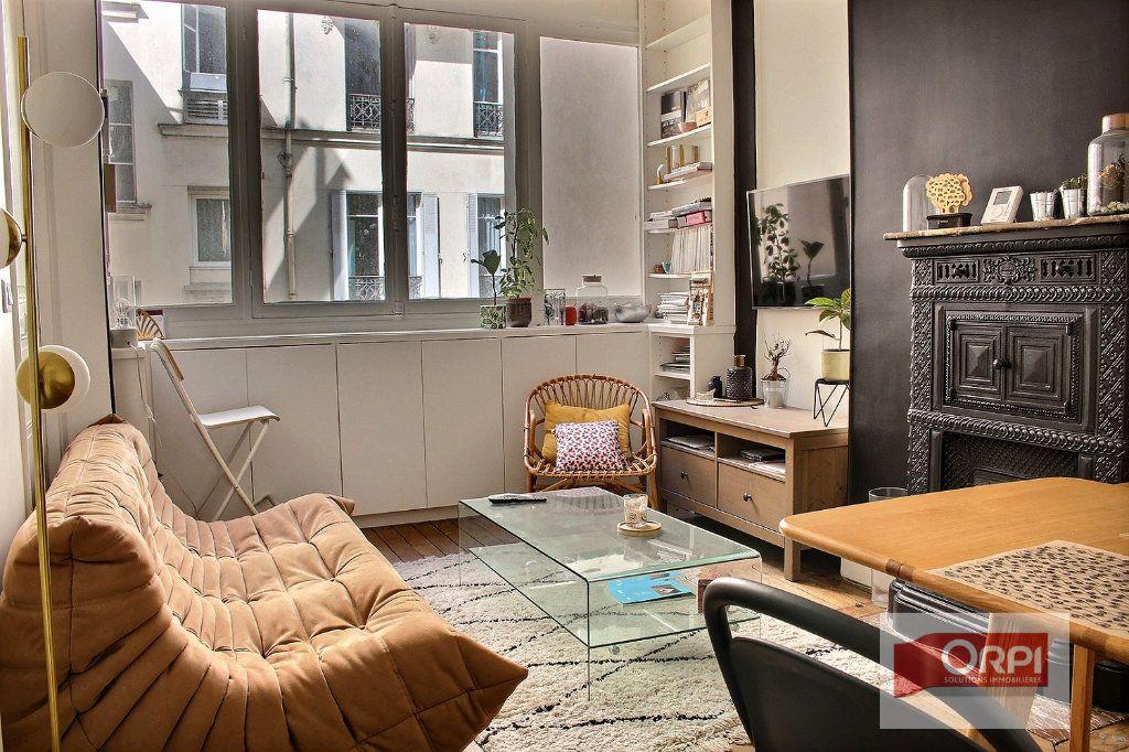 Appartement à vendre 2 38m2 à Paris 19 vignette-1