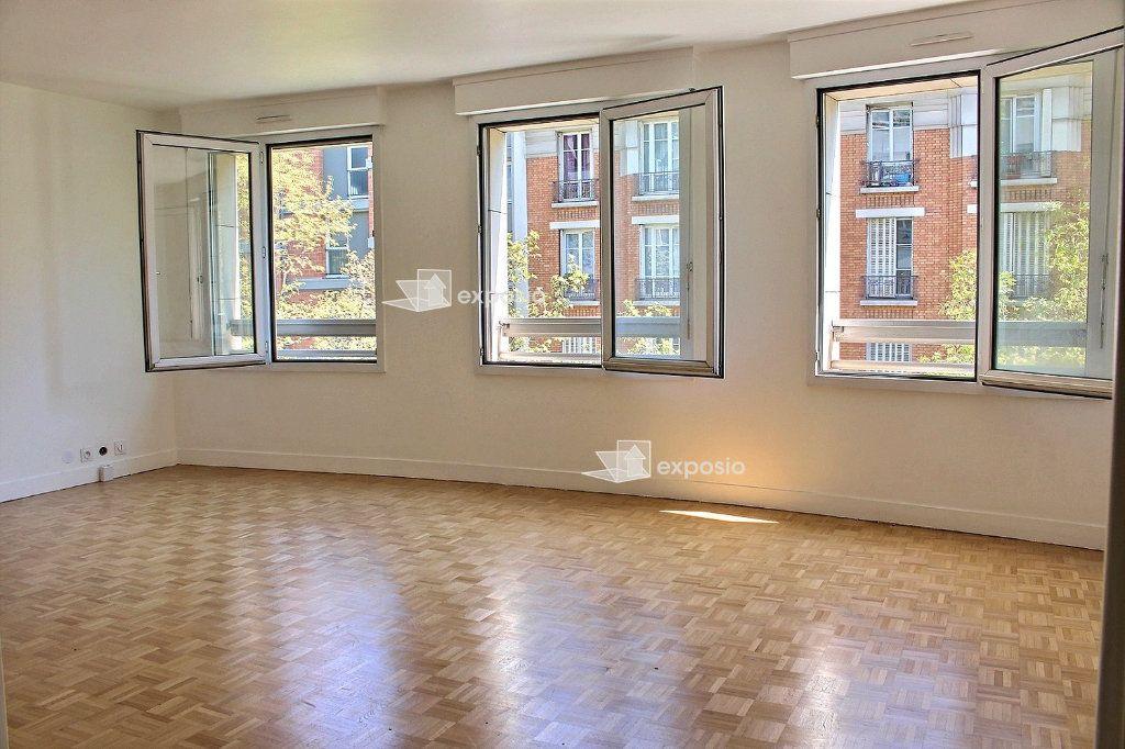 Appartement à vendre 4 95.5m2 à Paris 19 vignette-1