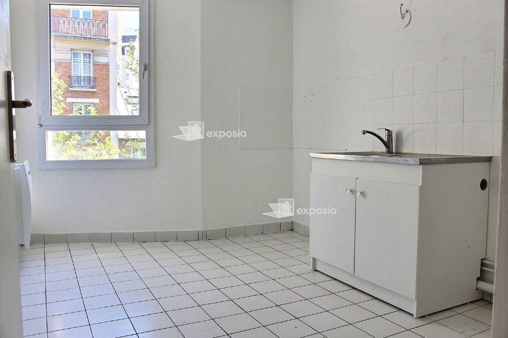 Appartement à vendre 4 95.5m2 à Paris 19 vignette-2