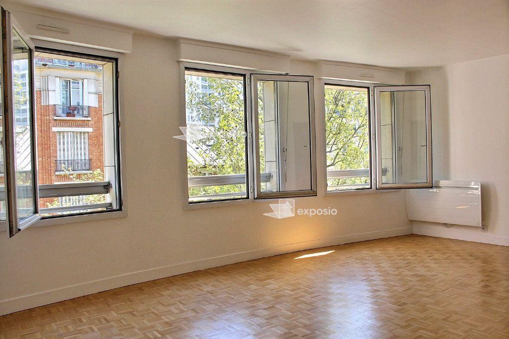 Appartement à vendre 4 95.5m2 à Paris 19 vignette-4