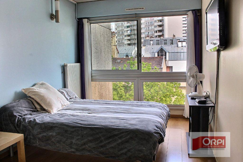 Appartement à vendre 4 87m2 à Paris 19 vignette-5