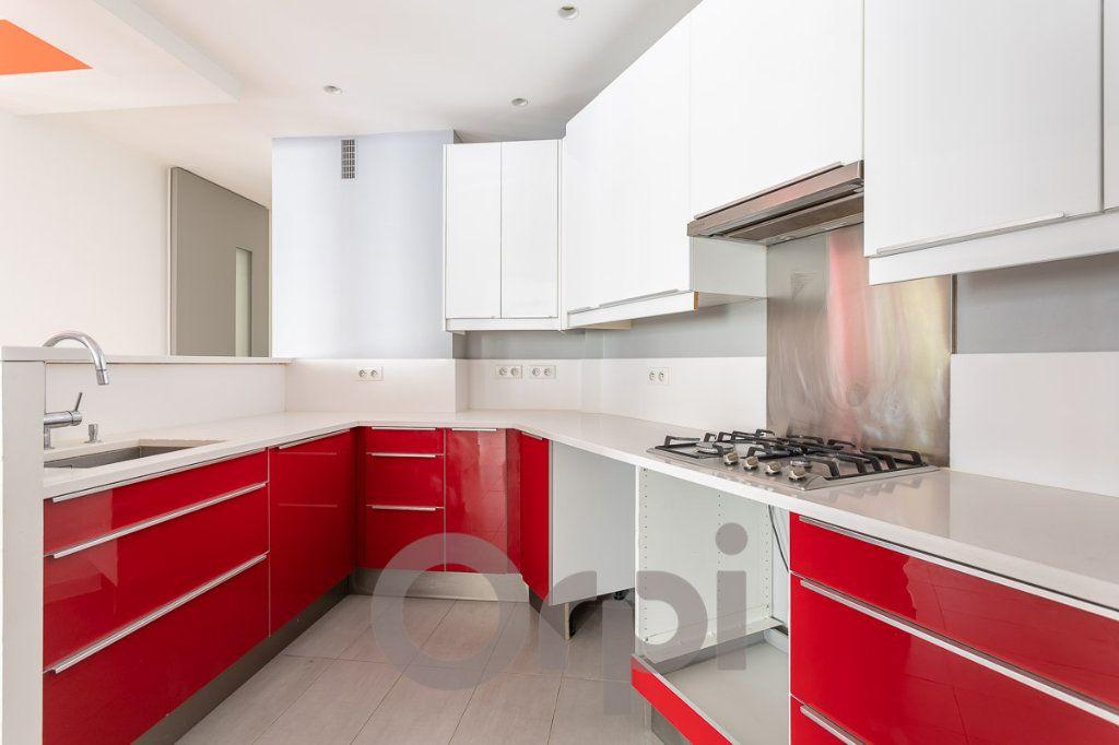 Appartement à vendre 5 117.09m2 à Paris 19 vignette-4