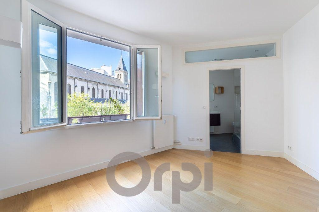 Appartement à vendre 5 117.09m2 à Paris 19 vignette-6