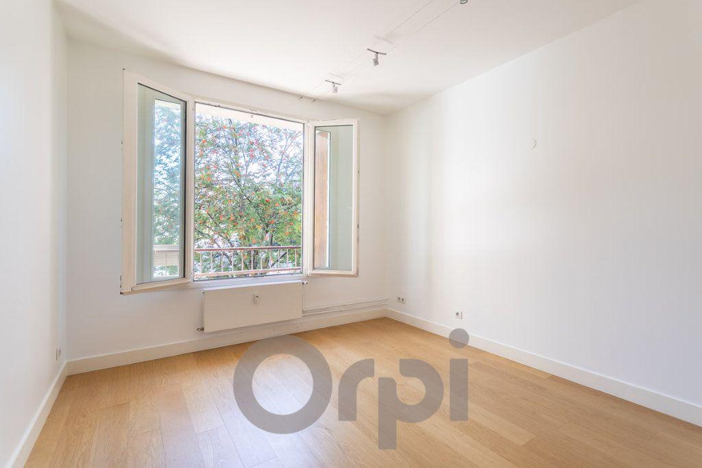 Appartement à vendre 5 117.09m2 à Paris 19 vignette-7