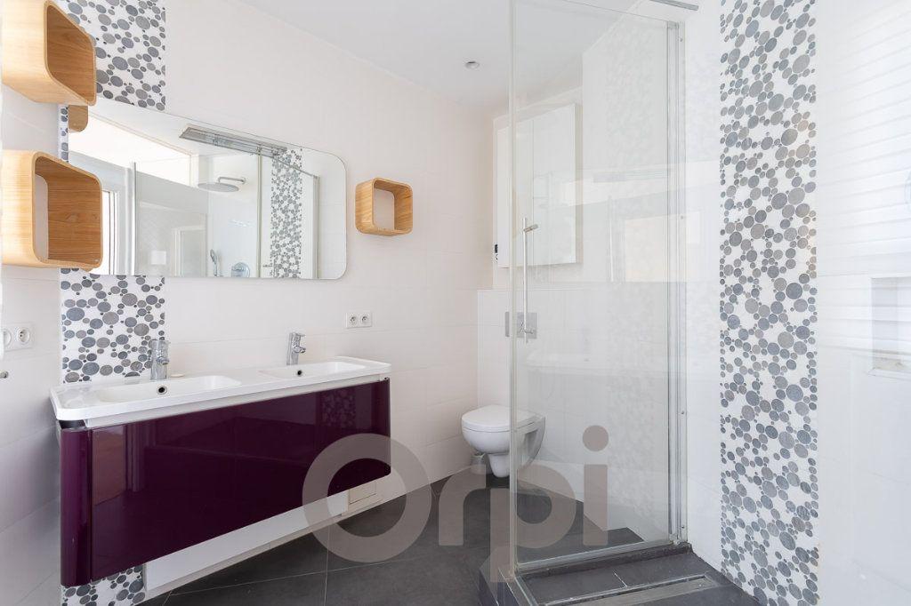 Appartement à vendre 5 117.09m2 à Paris 19 vignette-9