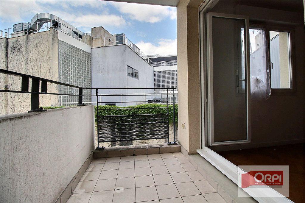 Appartement à vendre 2 49.92m2 à Paris 19 vignette-4