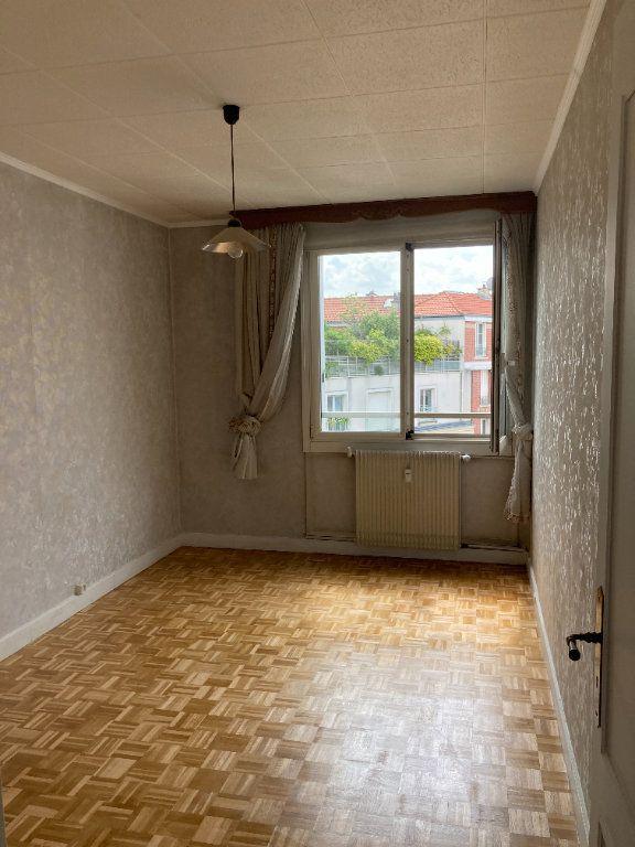Appartement à louer 3 68m2 à Paris 20 vignette-7