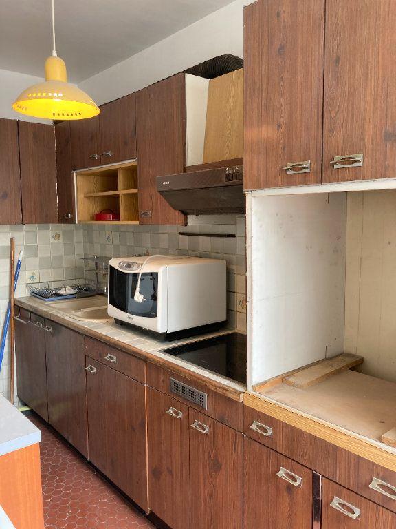 Appartement à louer 3 68m2 à Paris 20 vignette-11