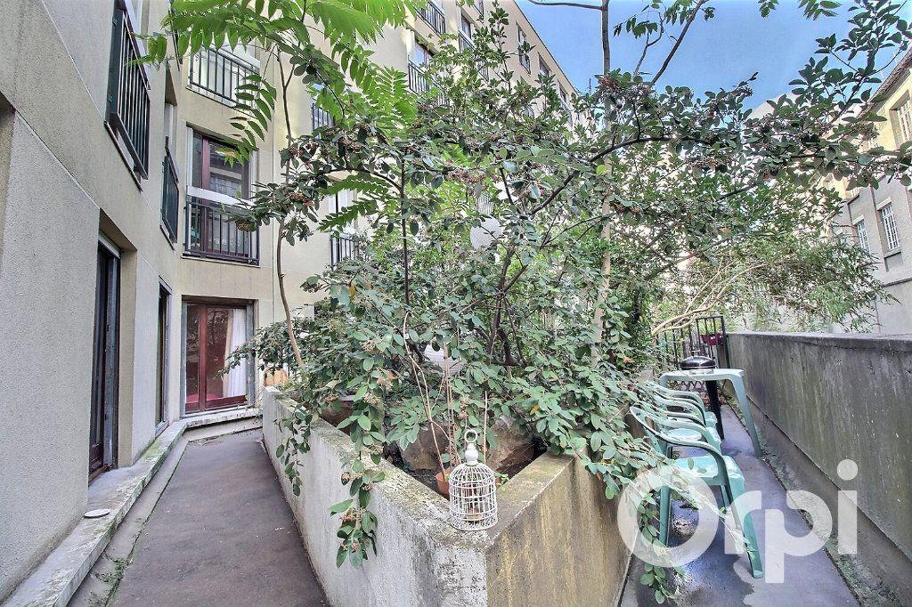 Appartement à vendre 3 72m2 à Paris 19 vignette-2