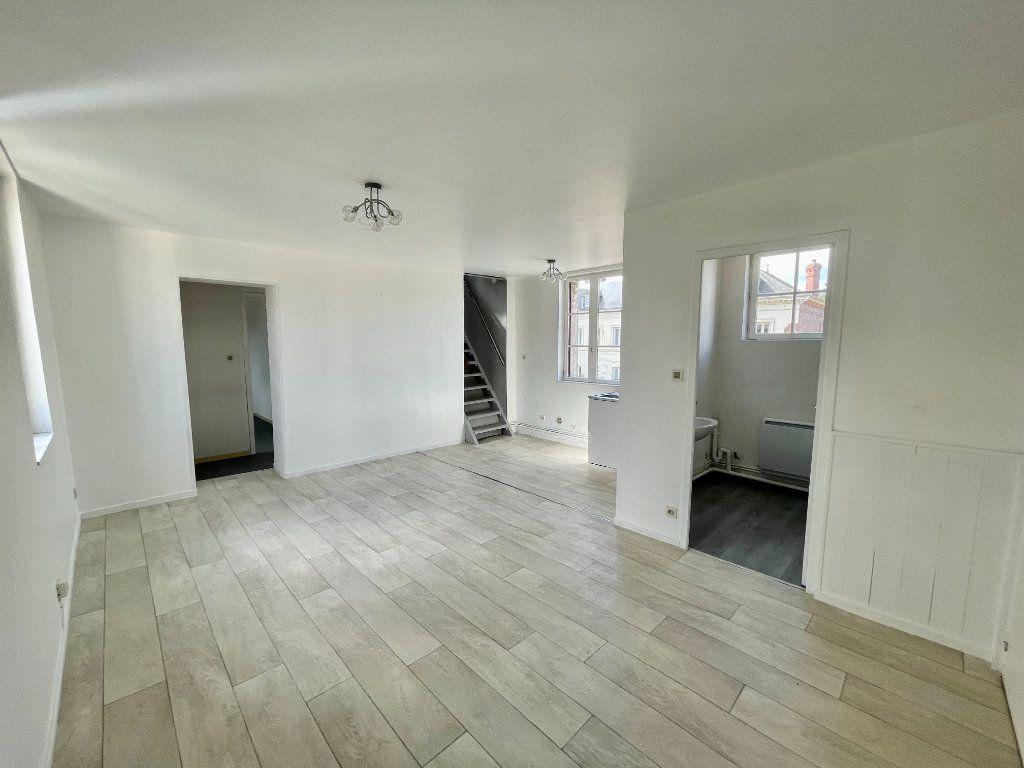 Appartement à louer 4 56.99m2 à Bourg-Achard vignette-2