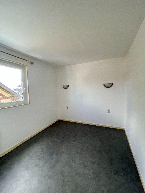 Appartement à louer 4 56.99m2 à Bourg-Achard vignette-4