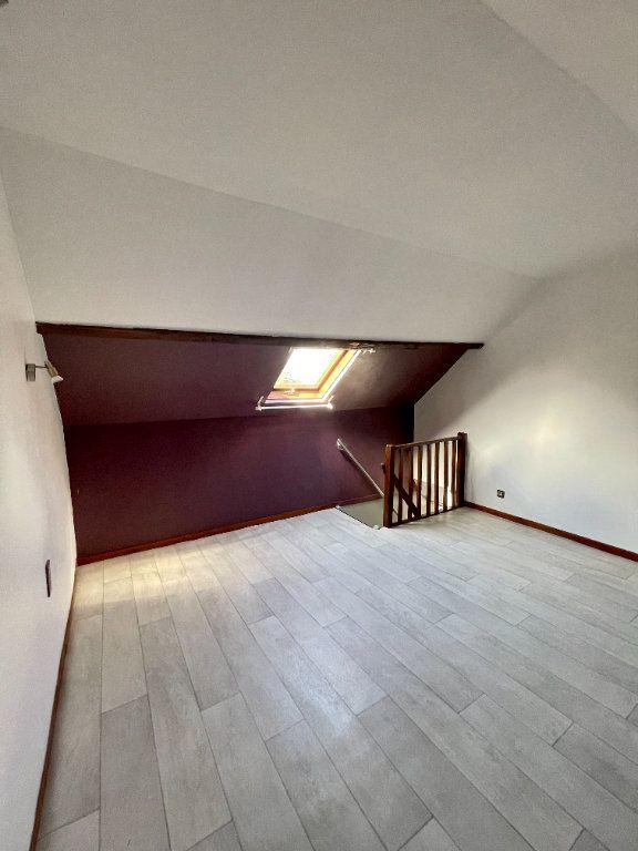 Appartement à louer 4 56.99m2 à Bourg-Achard vignette-5