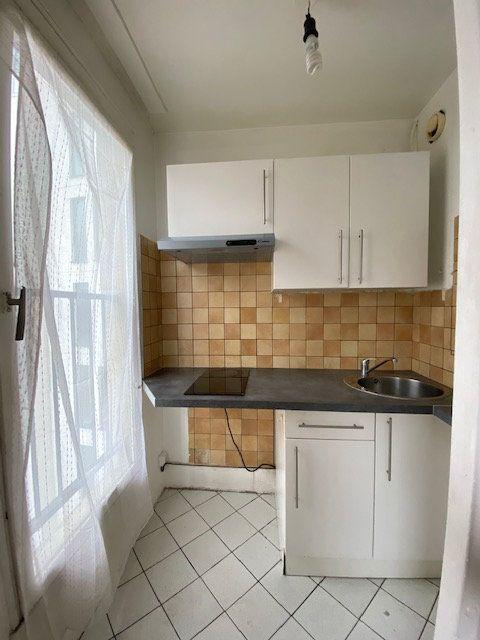 Appartement à louer 1 33.13m2 à Paris 18 vignette-4