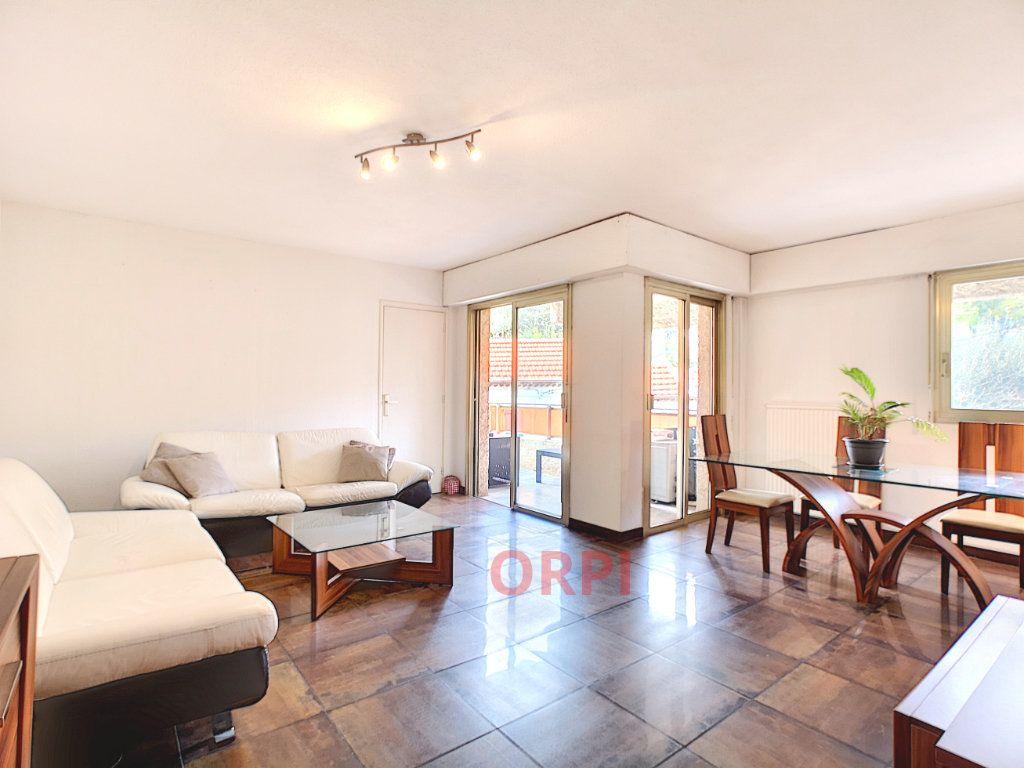 Appartement à vendre 3 64.48m2 à Le Cannet vignette-2