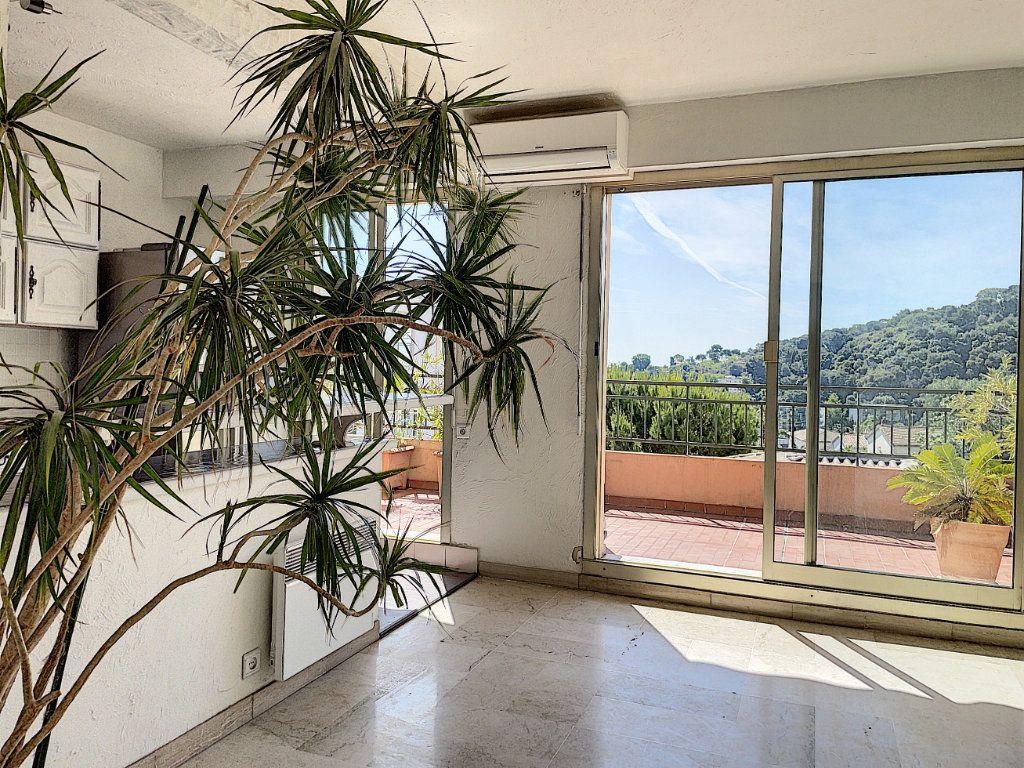 Appartement à vendre 4 91m2 à Cagnes-sur-Mer vignette-2