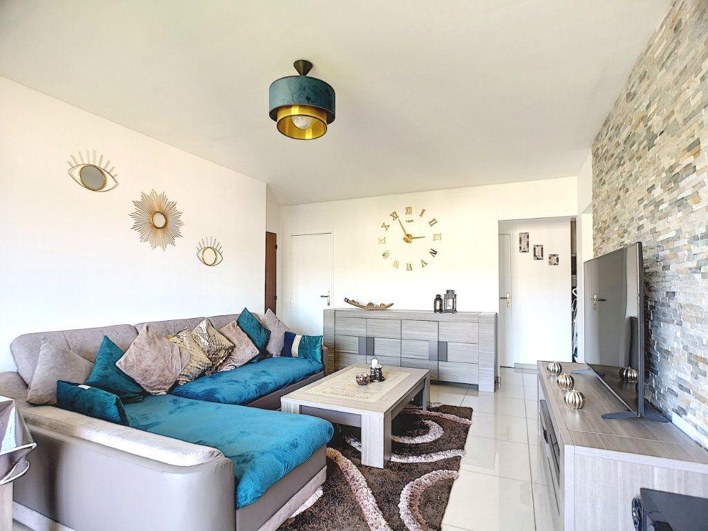Appartement à vendre 3 63.15m2 à Villeneuve-Loubet vignette-5
