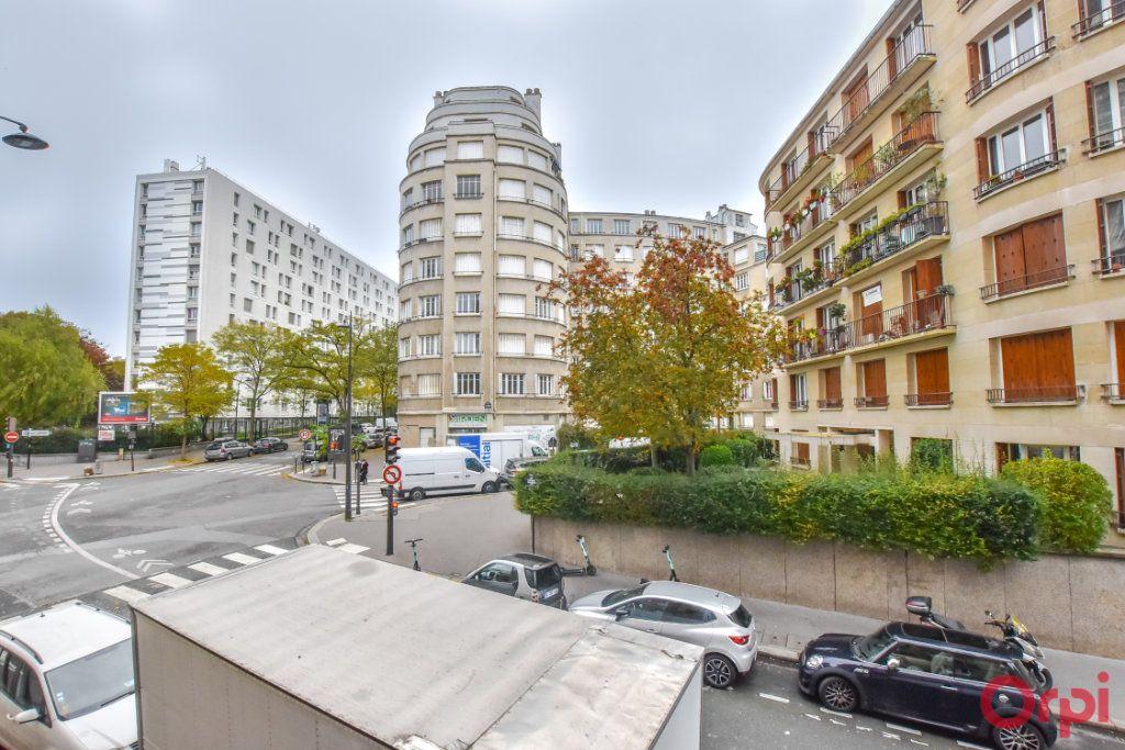 Appartement à vendre 4 94m2 à Paris 19 vignette-12