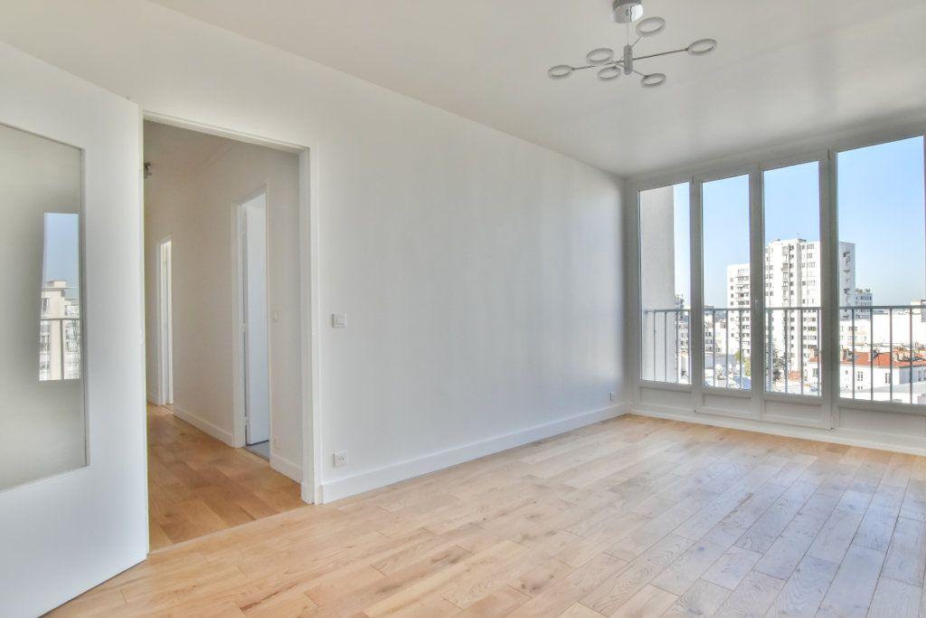 Appartement à vendre 2 49.41m2 à Paris 19 vignette-1