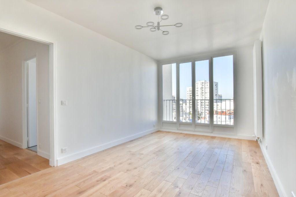 Appartement à vendre 2 49.41m2 à Paris 19 vignette-2