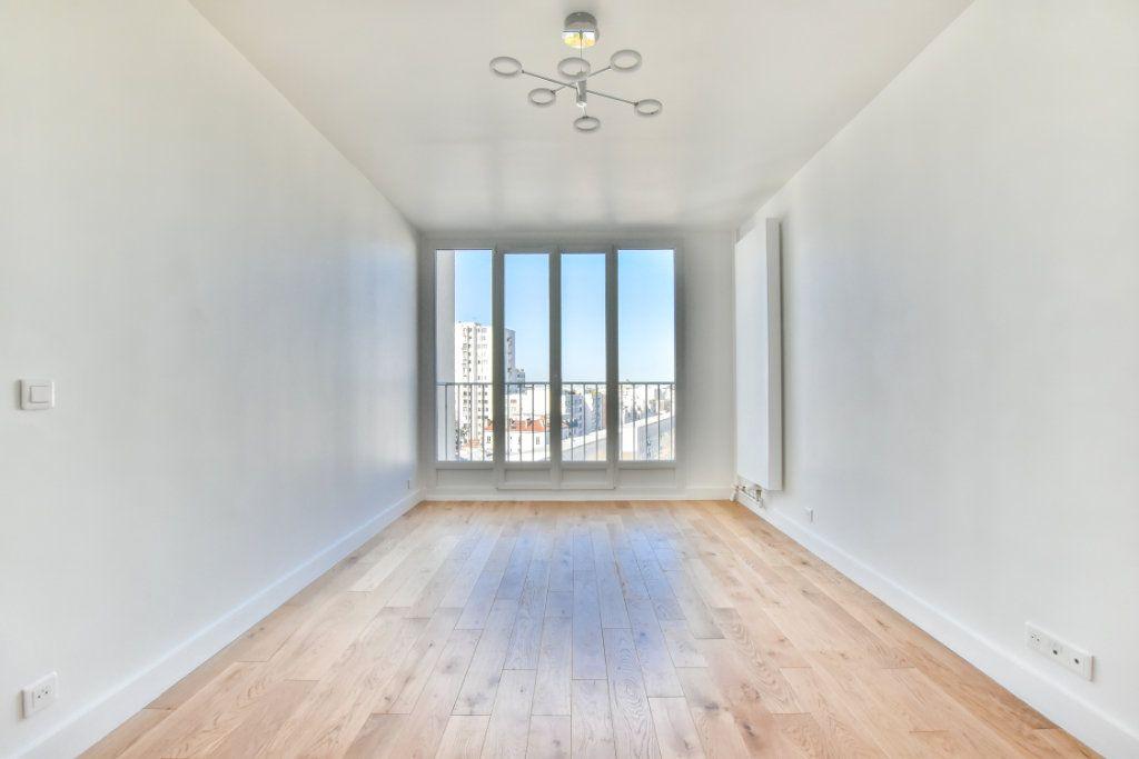 Appartement à vendre 2 49.41m2 à Paris 19 vignette-3