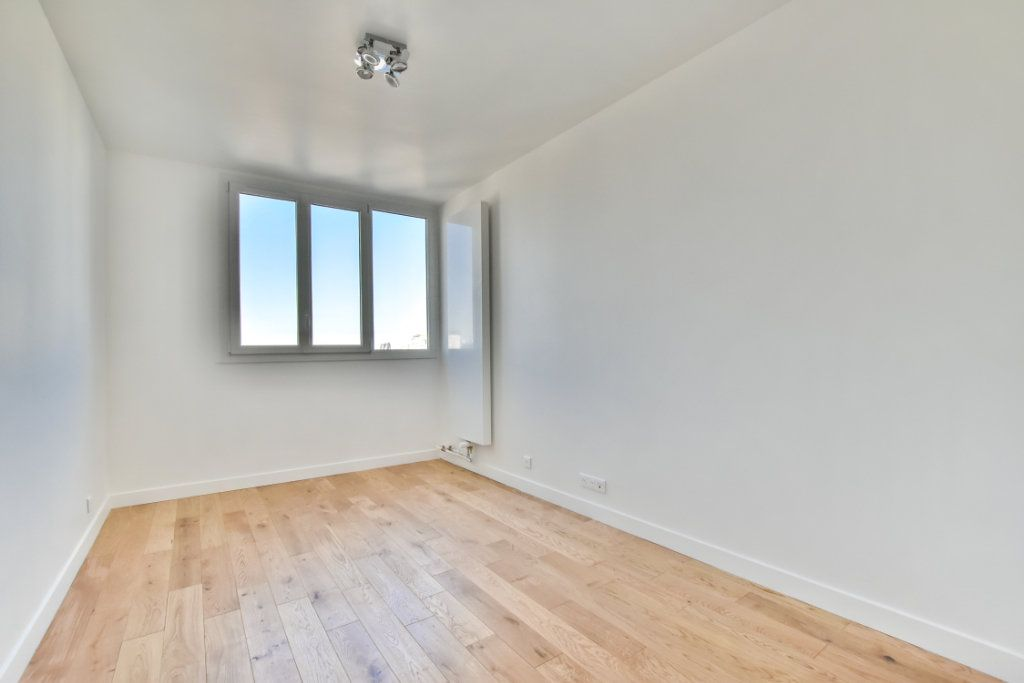 Appartement à vendre 2 49.41m2 à Paris 19 vignette-9