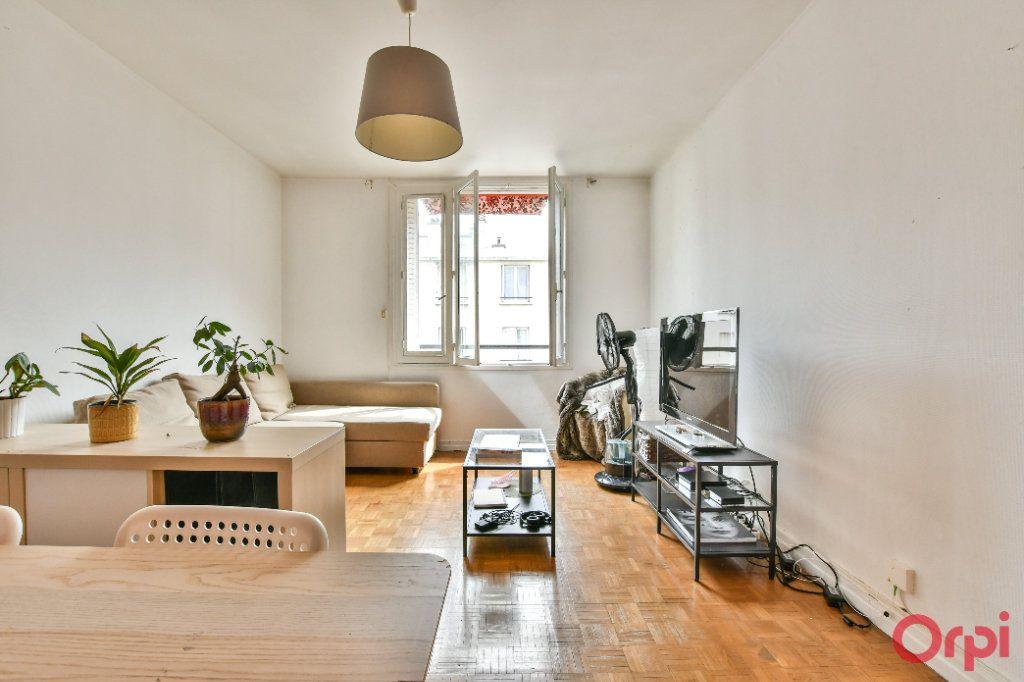 Appartement à vendre 2 51.1m2 à Paris 11 vignette-4