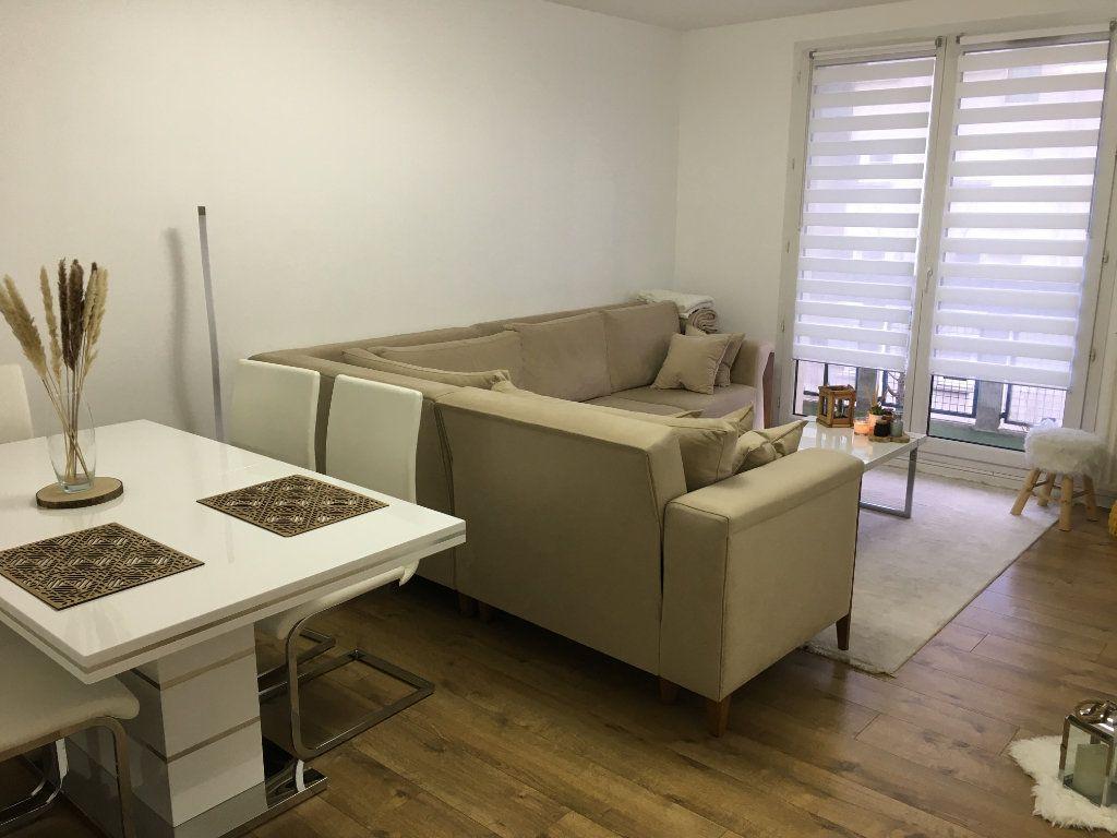 Appartement à vendre 3 61m2 à Saint-Ouen-l'Aumône vignette-1