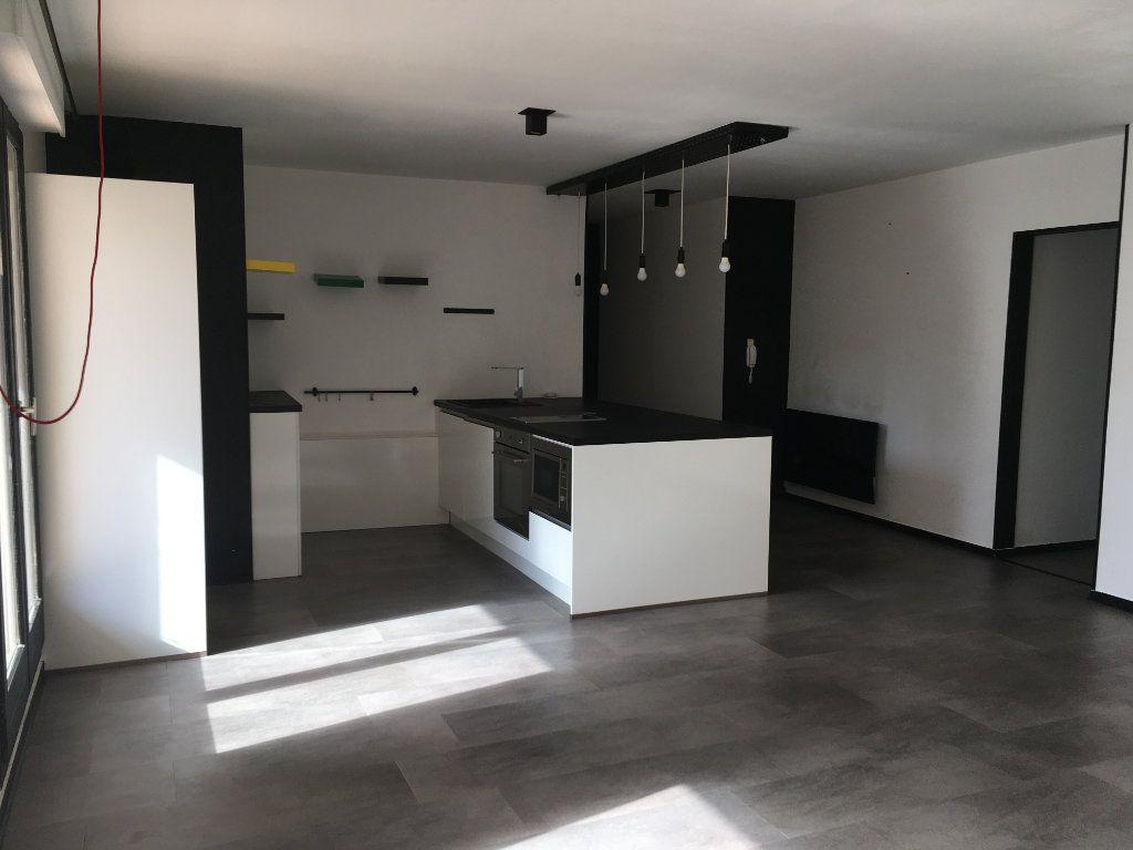 Appartement à louer 2 58.05m2 à Lyon 3 vignette-1