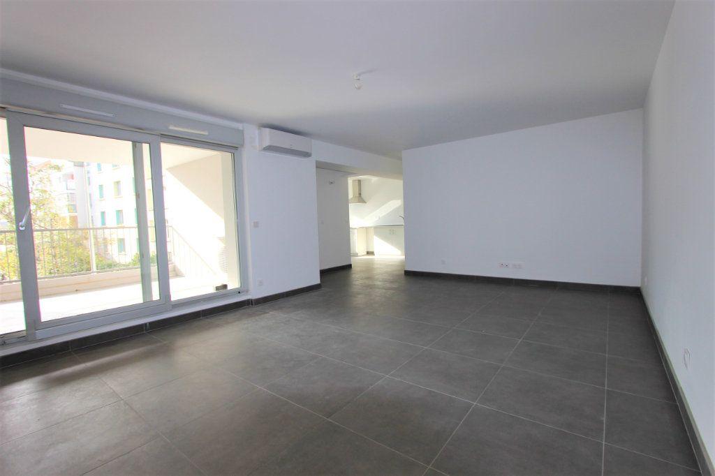 Appartement à vendre 4 85.66m2 à Lyon 3 vignette-2